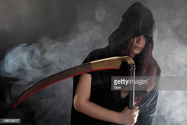 Female Grim Reaper holding a scythe