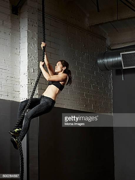 Female gym climbing rope