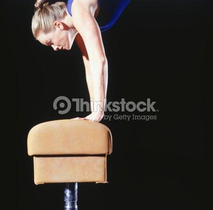 female gymnast balanced on vaulting horse side view stock foto thinkstock. Black Bedroom Furniture Sets. Home Design Ideas