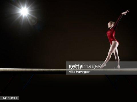 Female Gymnast Balancing on Beam
