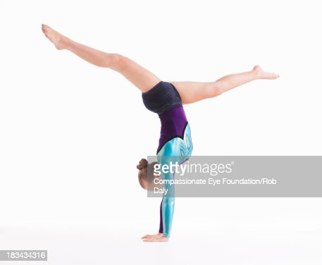 Female gymnast doing handstand