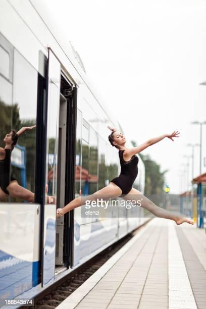Female Gymnast Jumping Off Train