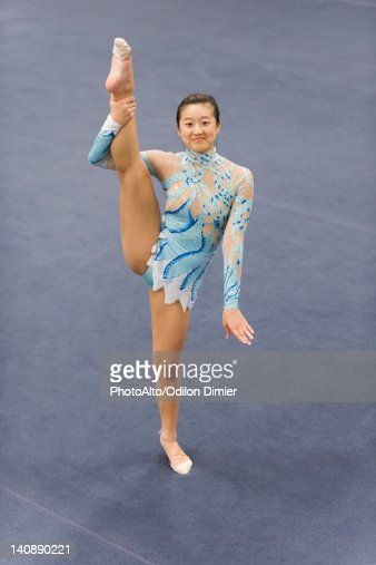 Female Gymnast Performing Floor Routine Stock Photo