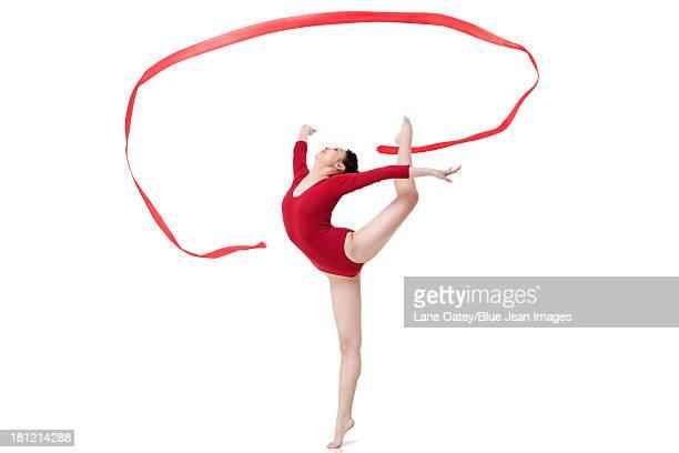 Female gymnast performing rhythmic gymnastics with ribbon