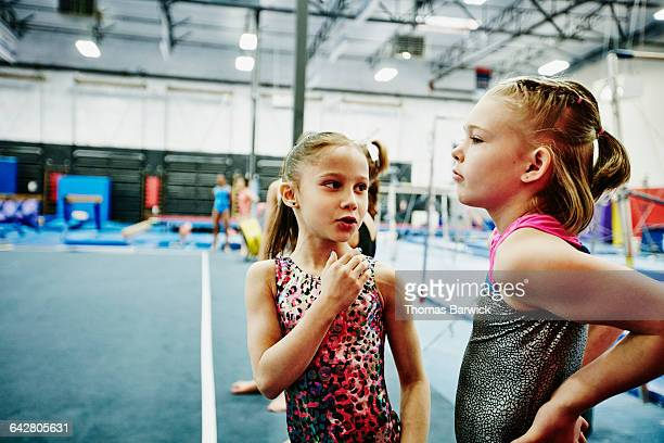 Female gymnasts waiting to perform floor routine
