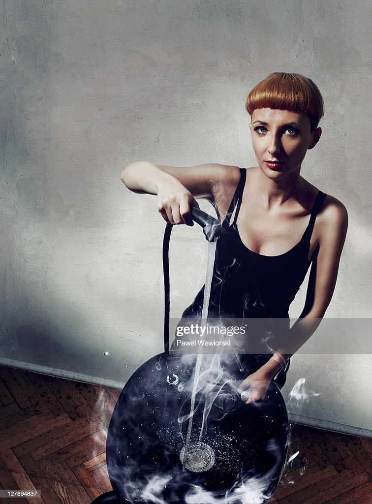 Female hairdresser with hair washer in hand : Stock Photo