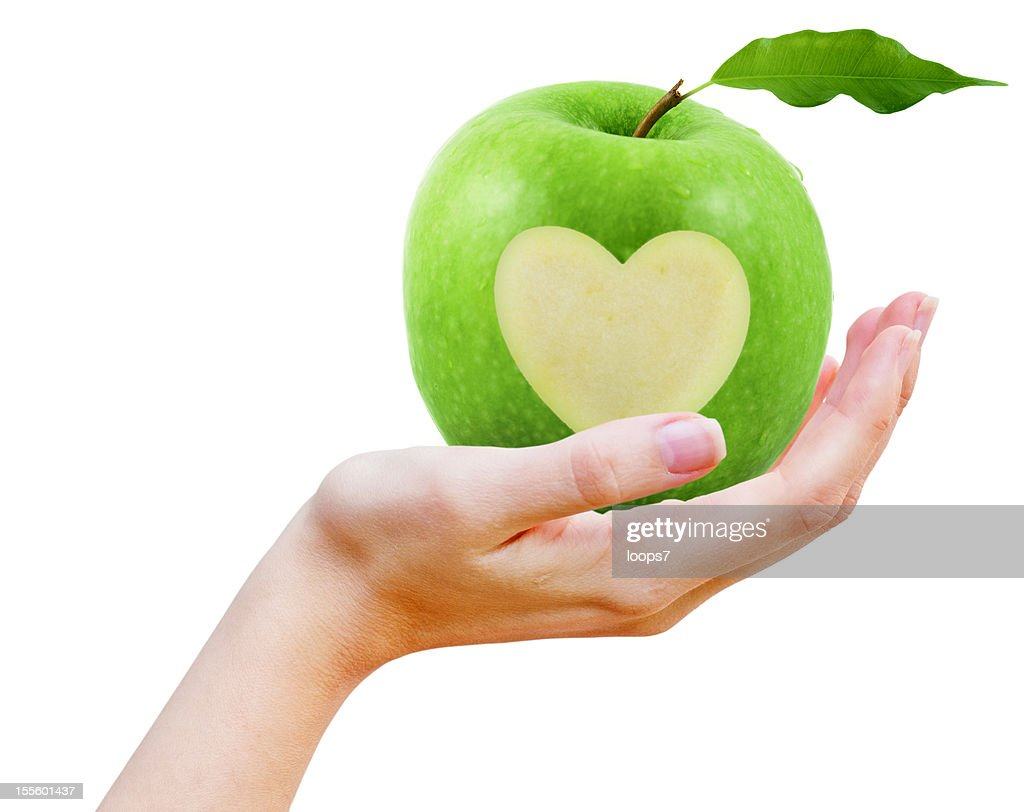 Female hand and fresh apple
