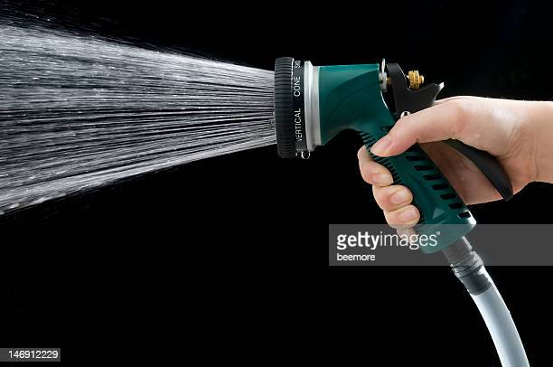 Female Hand Grabbing Green Water Nozzle