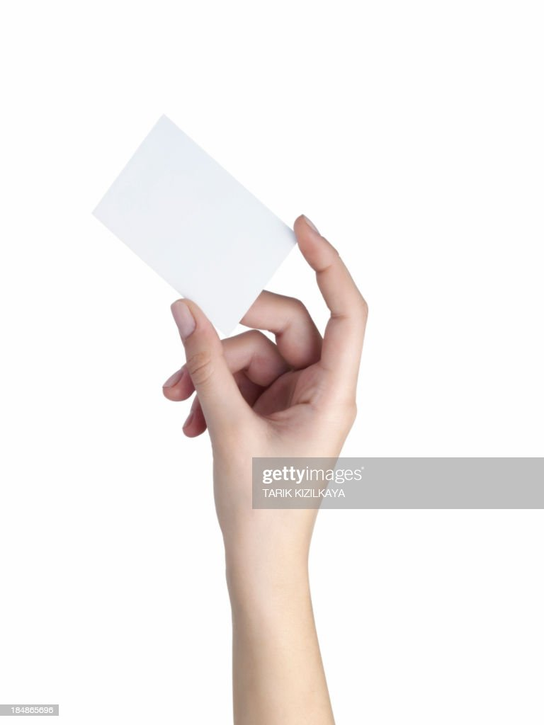 female hand holding a businesscard