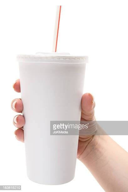 Female hand holds white disposable cup