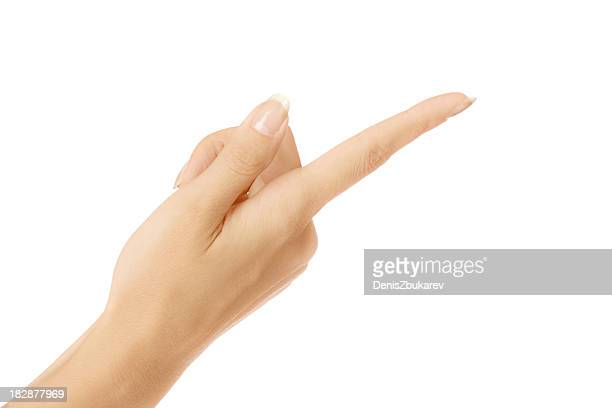 Female hand pointing upside down with index finger on white