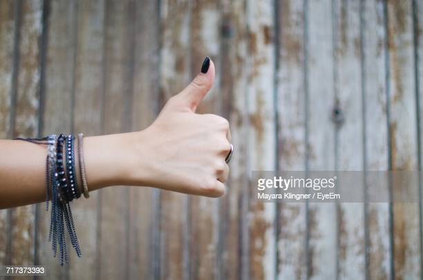 Female Hand Showing Thumbs Up