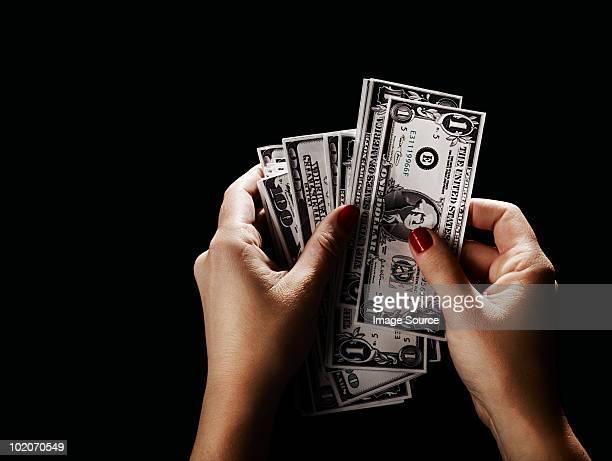 Female hand with dollar bills