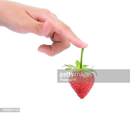 female hand with fresh strawberry isolated on white : Stock Photo