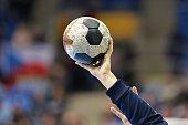 Female Handball Player holding a handball