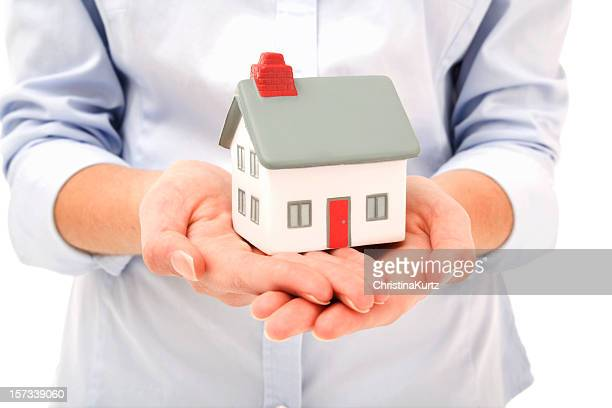 Female hands holding concept house