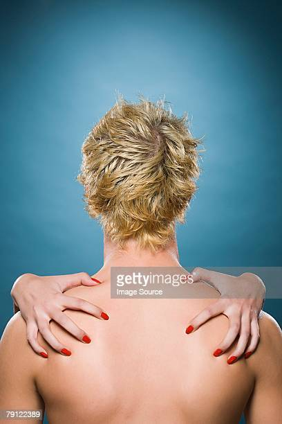 Female hands on male back