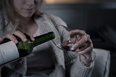 Close-up of female hands pouring red wine
