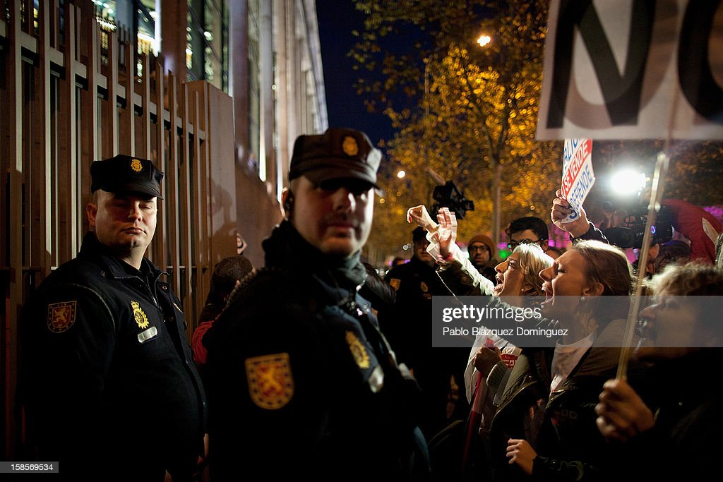 Female health workers shout slogans in front of riot police during a demonstration outside Madrid Regional Asembly on December 19, 2012 in Madrid, Spain. As of today, health workers unions are calling for a third 48-hour strike against cuts on public health care and the privatization of medical centers and hospitals.