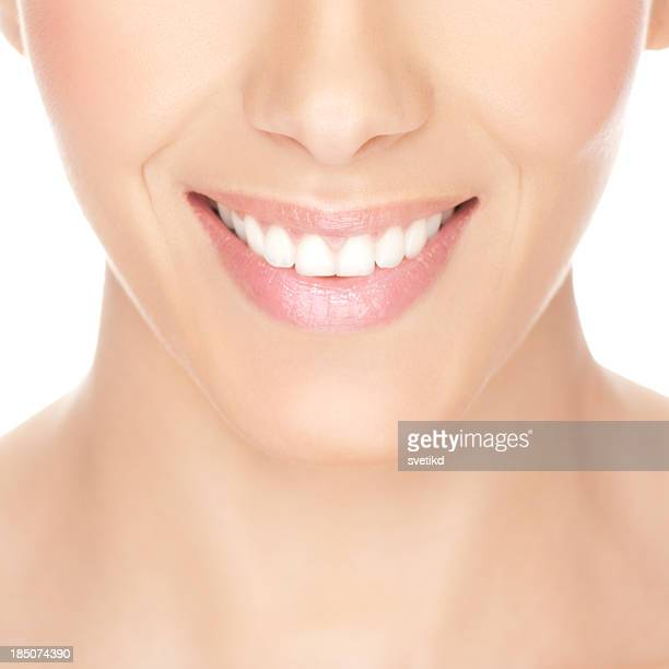 Female healthy white toothy smile.