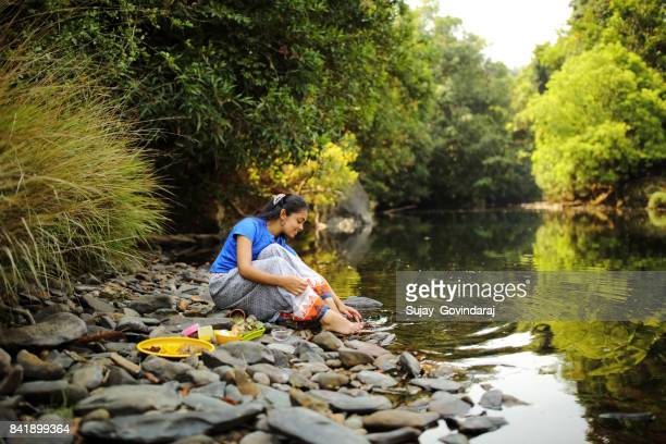 Female Herbalist Playing in River Water