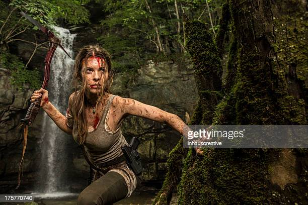 Female Heroine in the Jungle Hunting with Pick Axe