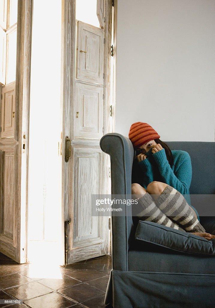 Female hides under winter cap. : Stock Photo