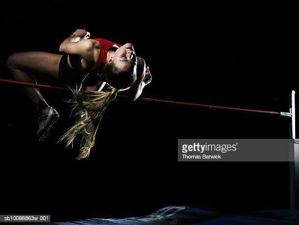 Female high jumper in motion