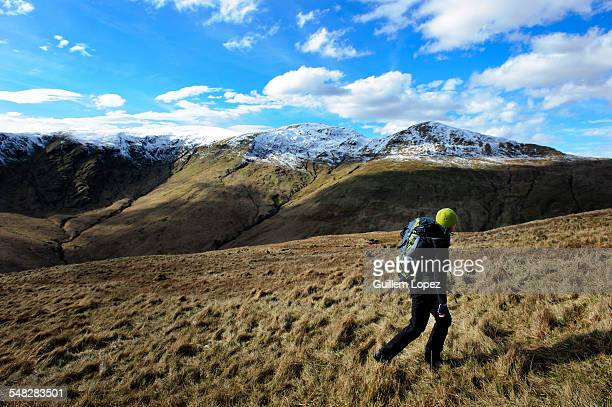 A female hiker at A female hiker at The Loch Lomond & The Trossachs National Park, Scotland, UK.