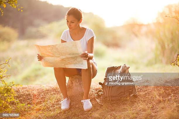 Female hiker looking at the map