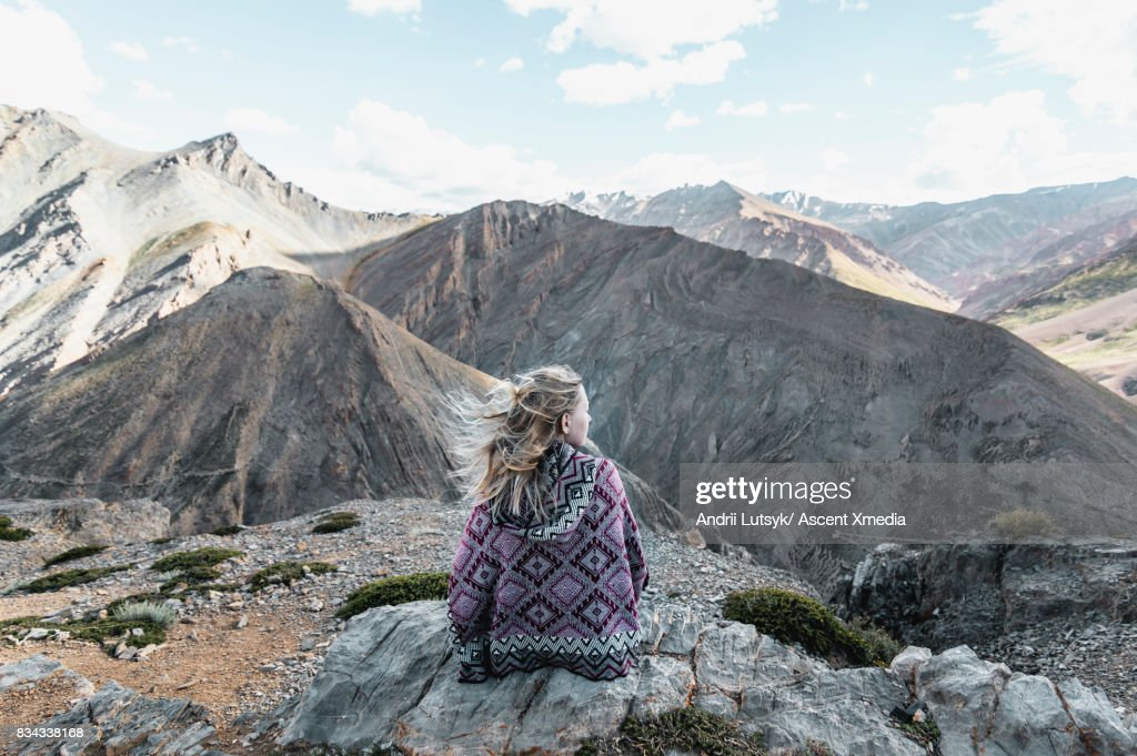 Female hiker relaxes in mountain landscape