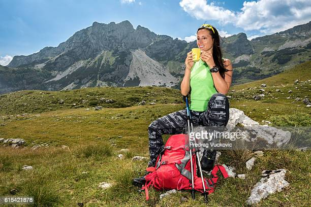Female hiker resting in the mountains