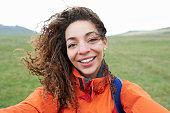 Female hiker taking self portrait