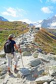 Female Hiker Walking on Mountain Track in the Swiss Alps
