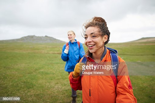Female hikers walking in countryside