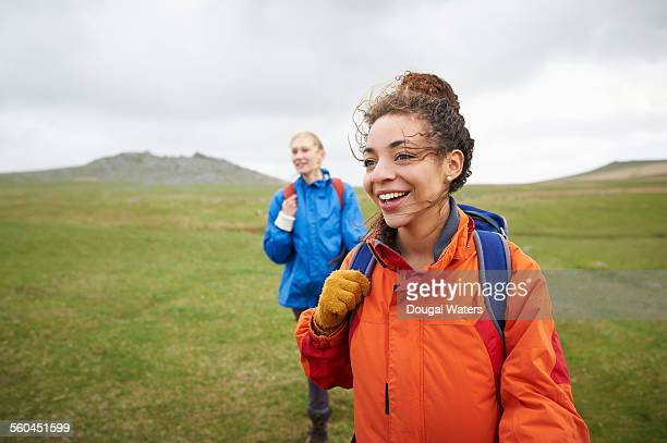 Female hikers walking in countryside