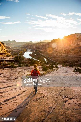 Female hiking trail at sunset