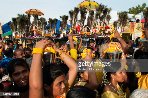 Female Hindu devotees carrying lotas with water during Thaipusam Festival at Batu Caves. : Stock Photo