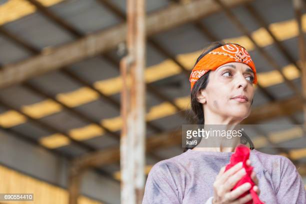 Female, Hispanic blue collar worker
