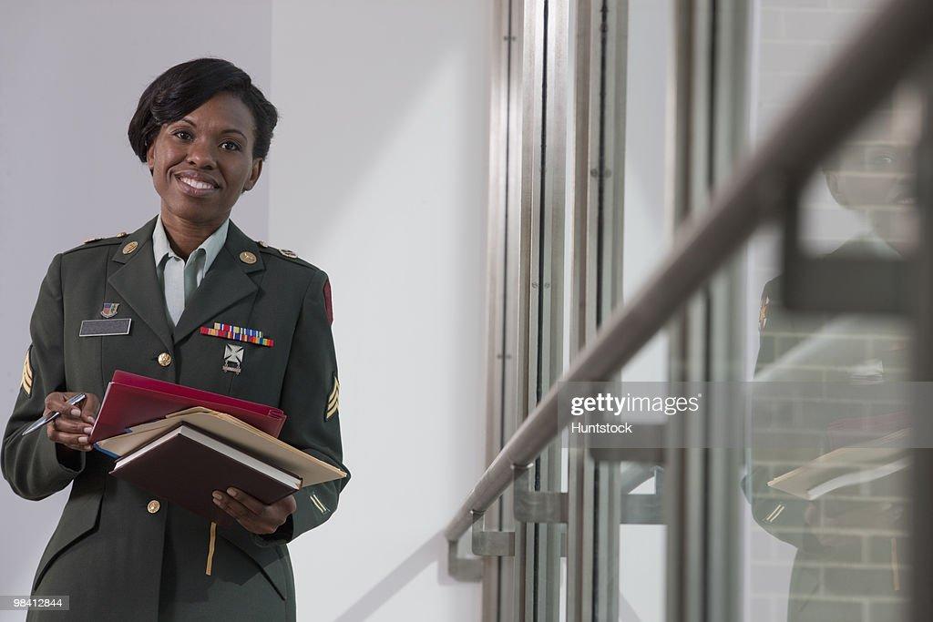 Female Hispanic nurse in the US army holding diaries
