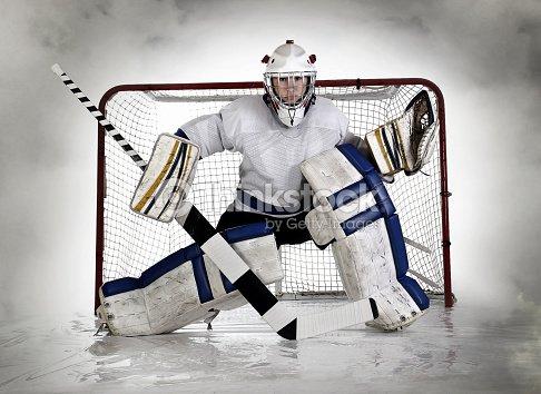 Female Hockey Goalie With Fog Background Stock Photo Thinkstock