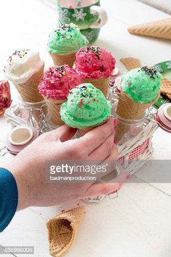 Female holding ice cream : Stock Photo
