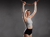 female holding on to arial hoop