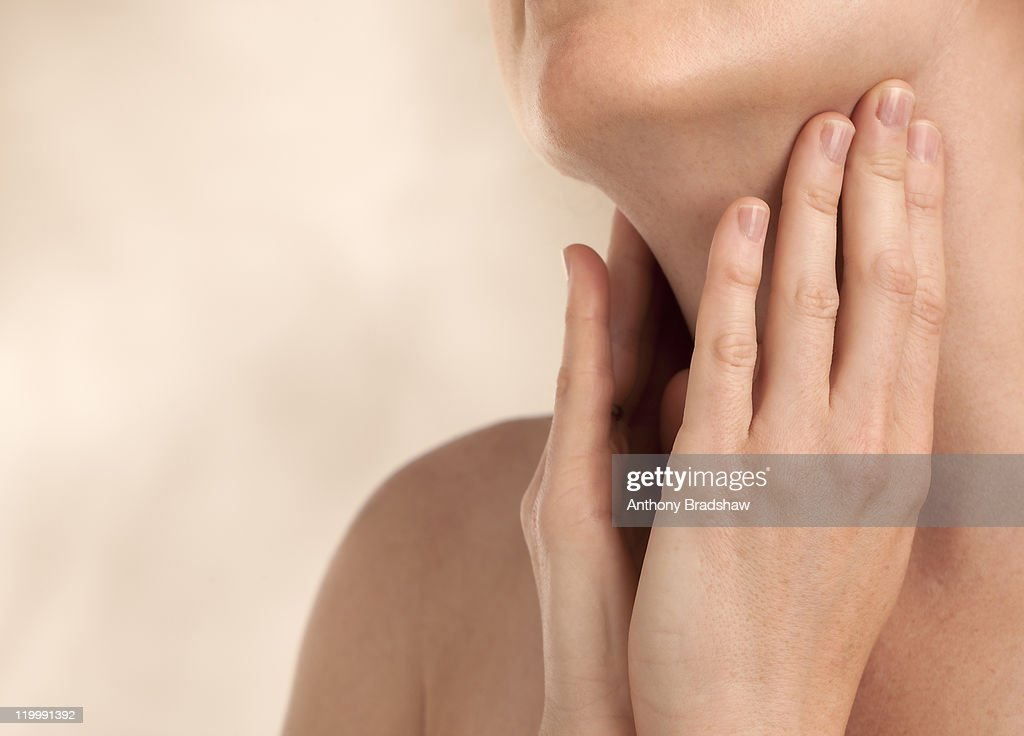 Female holding throat