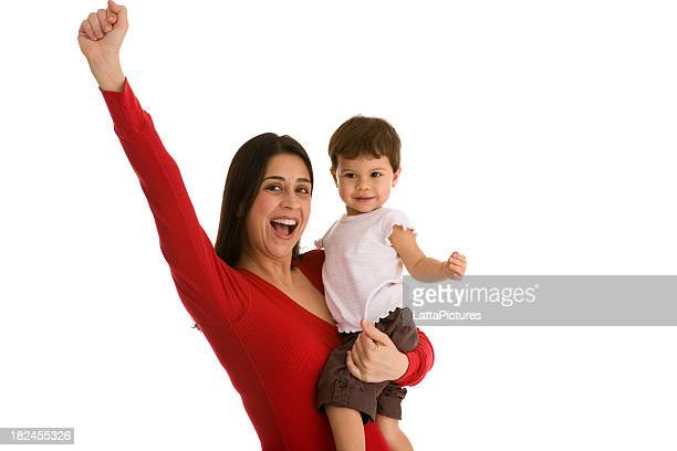 Female holding toddler gesturing fist in the air