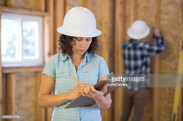 Female homeowner going over house building plans