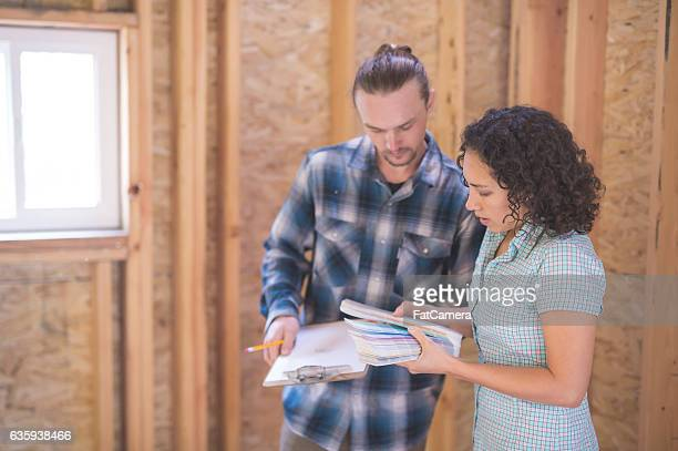 Female homeowner looking at paint chips with a male