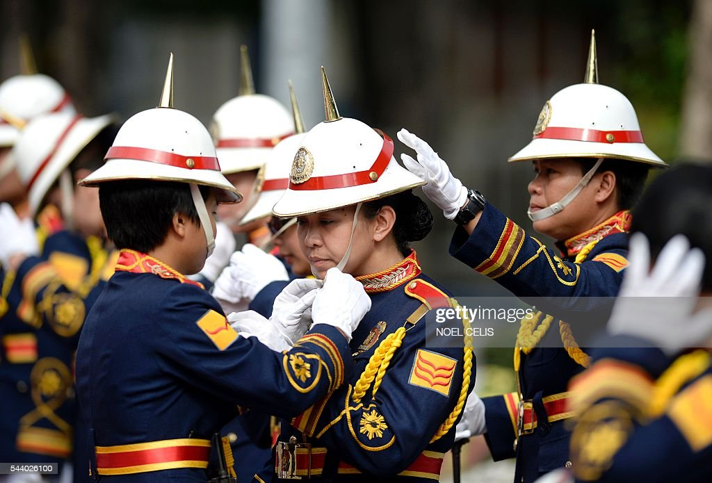 Female honour guards prepare for the arrival of Philippine President Rodrigo Duterte for Philippine National Police (PNP) chief Ronald Bato Dela Rosa's Assumption of Command Ceremony at the Camp Crame in Manila on July 1, 2016. Authoritarian firebrand Rodrigo Duterte was sworn in as the Philippines' president on June 30, after promising a ruthless and deeply controversial war on crime would be the main focus of his six-year term. / AFP / NOEL