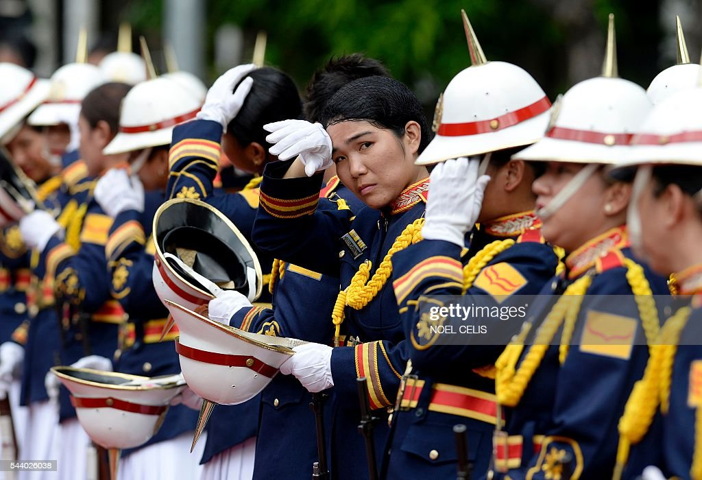 Female honour guards wait for the arrival of Philippine President Rodrigo Duterte for Philippine National Police (PNP) chief Ronald Bato Dela Rosa's Assumption of Command Ceremony at the Camp Crame in Manila on July 1, 2016. Authoritarian firebrand Rodrigo Duterte was sworn in as the Philippines' president on June 30, after promising a ruthless and deeply controversial war on crime would be the main focus of his six-year term. / AFP / NOEL