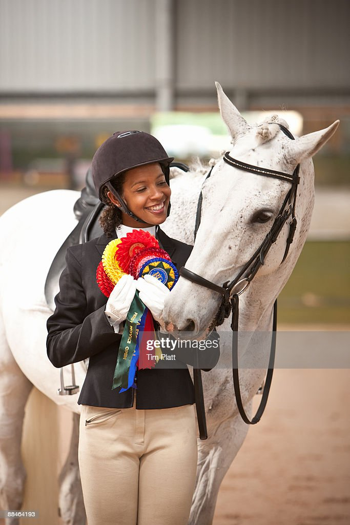 Female horse rider with winners rosettes. : Stock Photo